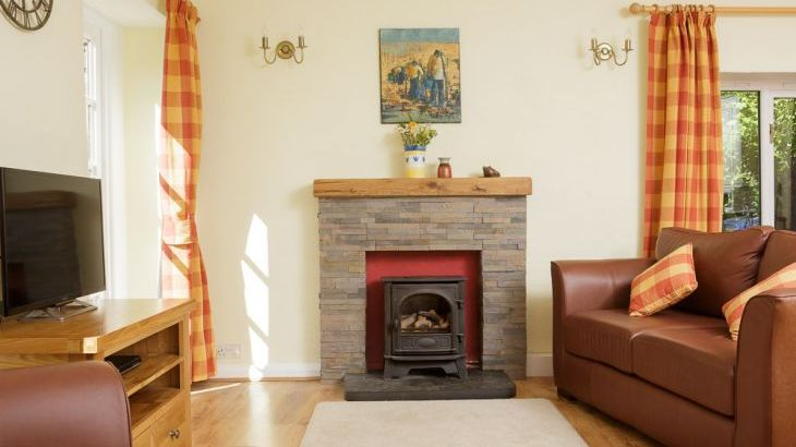Relax by the gas fired wood burning stove