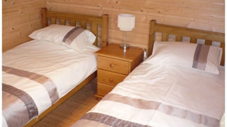 With two single beds, wardrobe and chest of drawers
