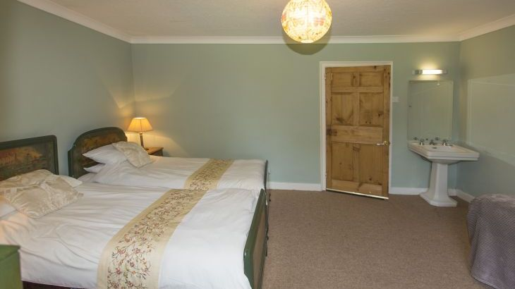 The Green bedroom has 3 singles beds