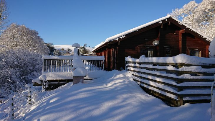 Snow at private lodge with hot tub