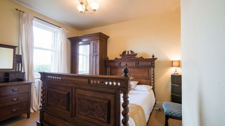 The Oak bedroom has a pretty antique french bed