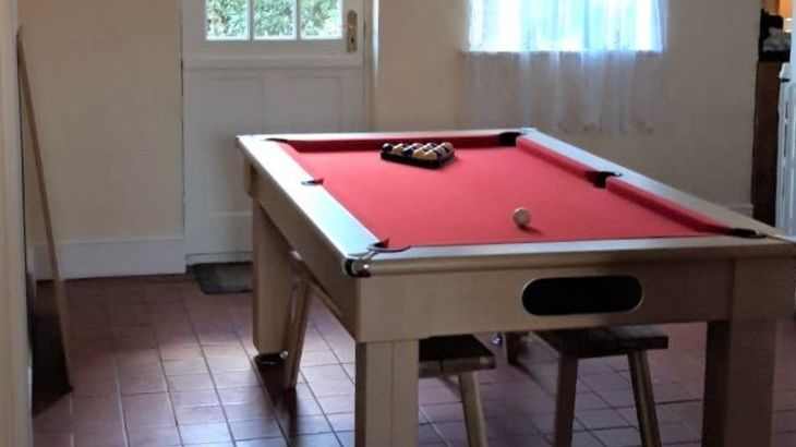 Dining / Pool Table in the breakfast room next to the patio