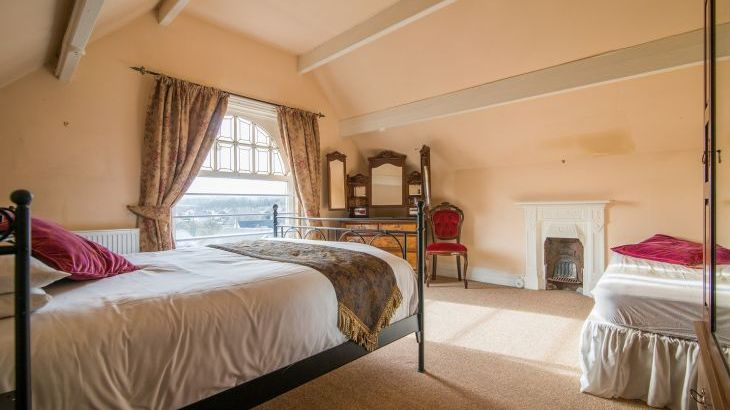 The Victorian bedroom has a king size bed and an extra single bed