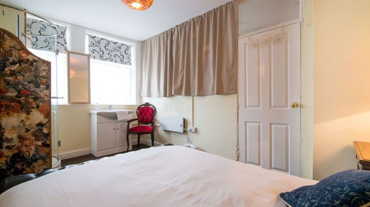 The ground floor bedroom has a shower and a wash basin.  The downstairs loo is opposite