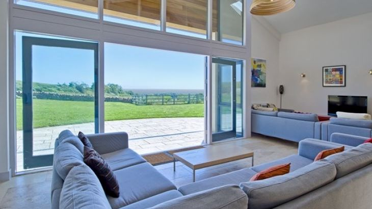 Open plan living space with sea views