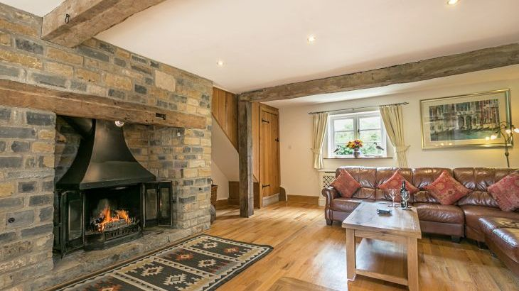 Lovely stone inglenook fireplace with wood burner - all logs provided