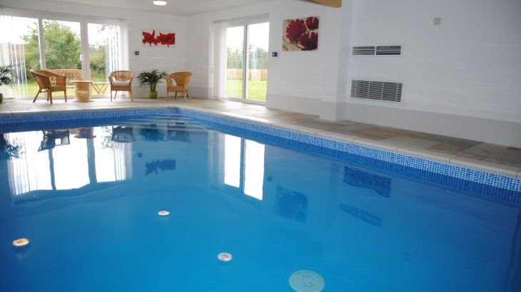 Large heated pool with slate flooring - exclusively yours