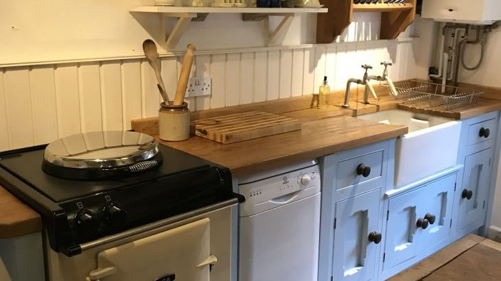 Country hand built kitchen featuring Aga, Welsher dresser, butchers block and Belfast sink.