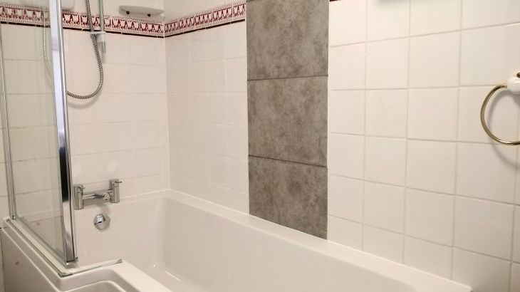 new bathroom suite, with bath and shower