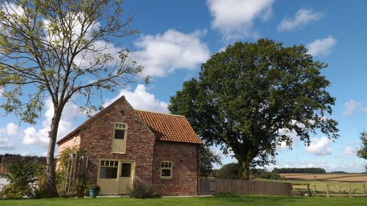 Brick cottage with fields around