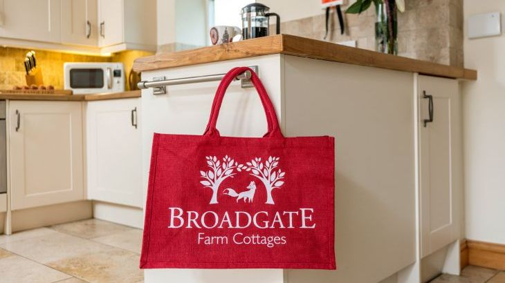 red broadgate Farm branded bag in a kitchen