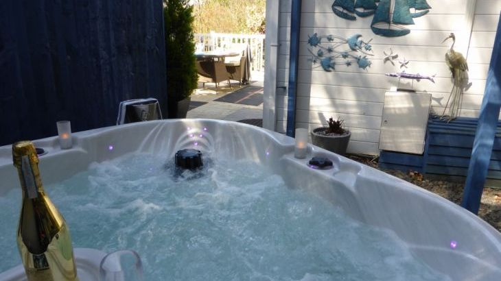 Romantic heart shaped spa hot tub under permanent cover to enjoy whatever the weather
