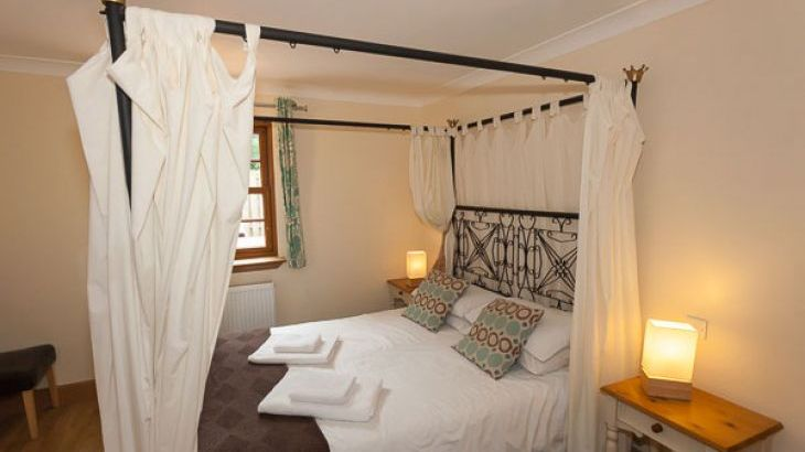 Romantic master bedroom at Rose Cottage