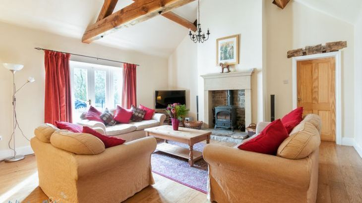 Large lounge with log burner and vaulted ceiling