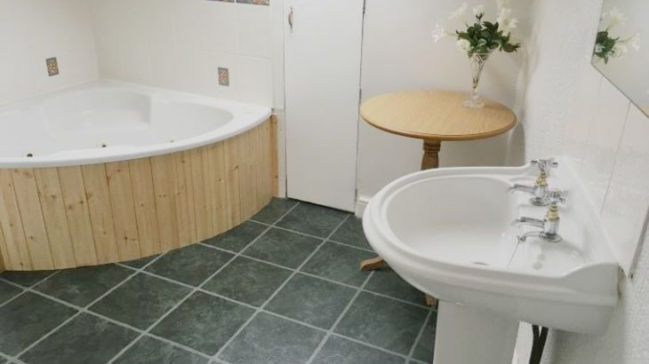 Bathroom with corner spa bath