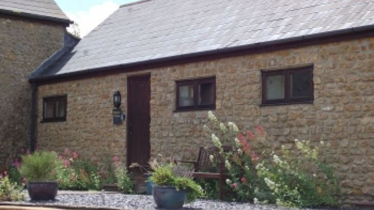 Bakers Mill Holiday Cottages nestling in The Axe Valley within dorsets Area of Outstanding Natural Beauty