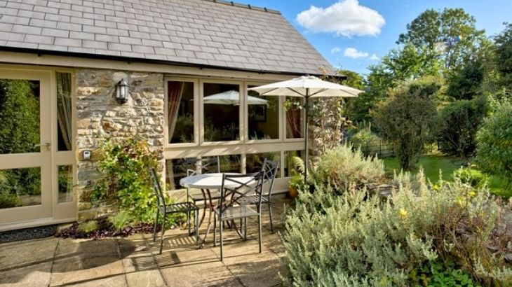 Set in beautiful gardens of listed mill