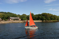 sailing holidays in scotland, stay in log cabins beside a loch